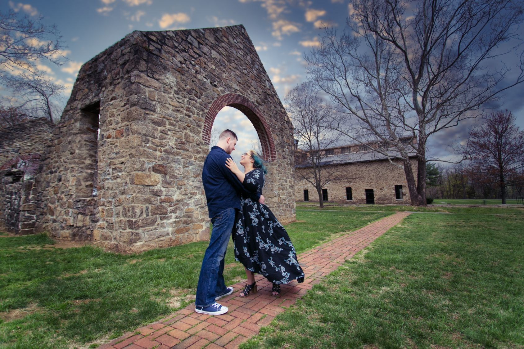 engagement photography couple stone building