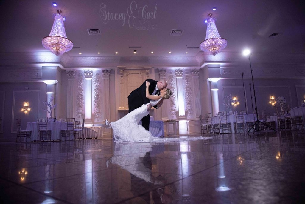 nj-wedding-photographer-groom-dipping-bride-valley-regency-wedding-venue